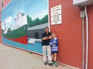 "With Jaden in Wallaceburg by an iconic mural of the old lake boat, ""Superior."""